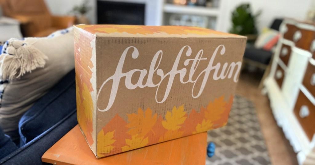 fabfitfun box next to the couch