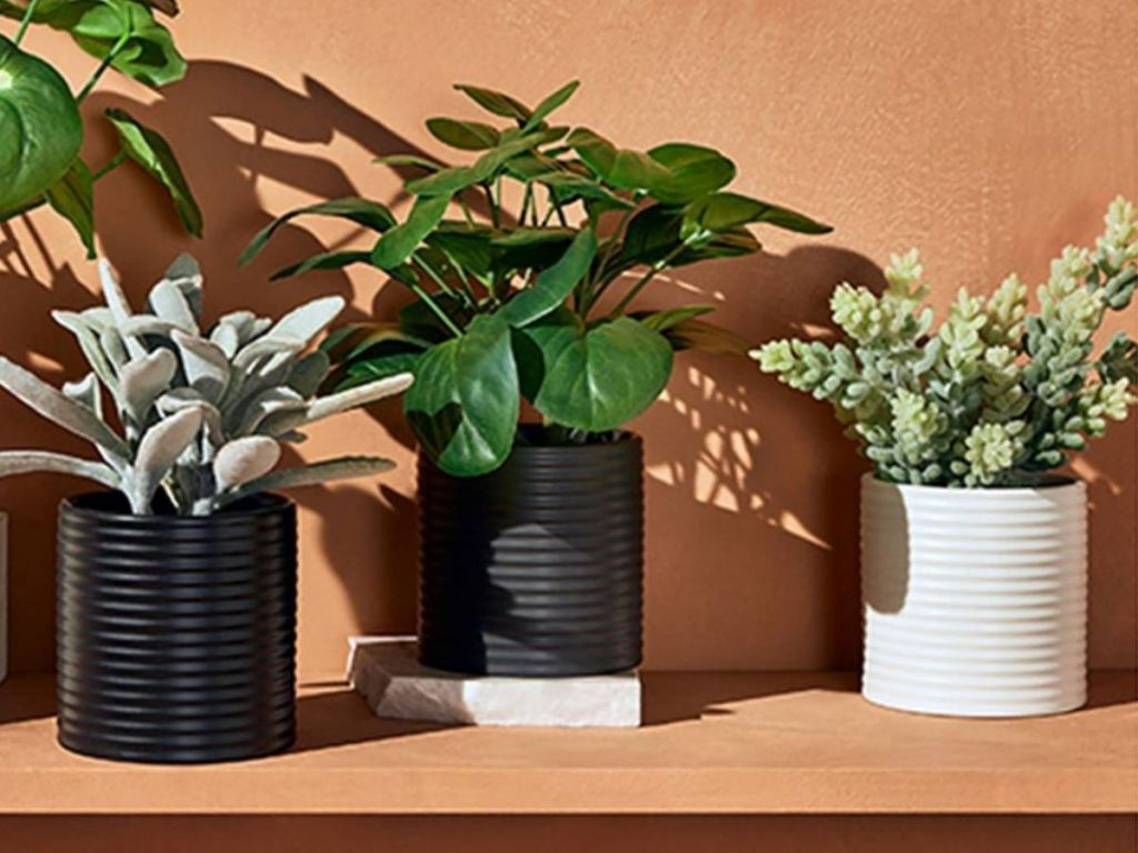 faux plants in ribbed pots