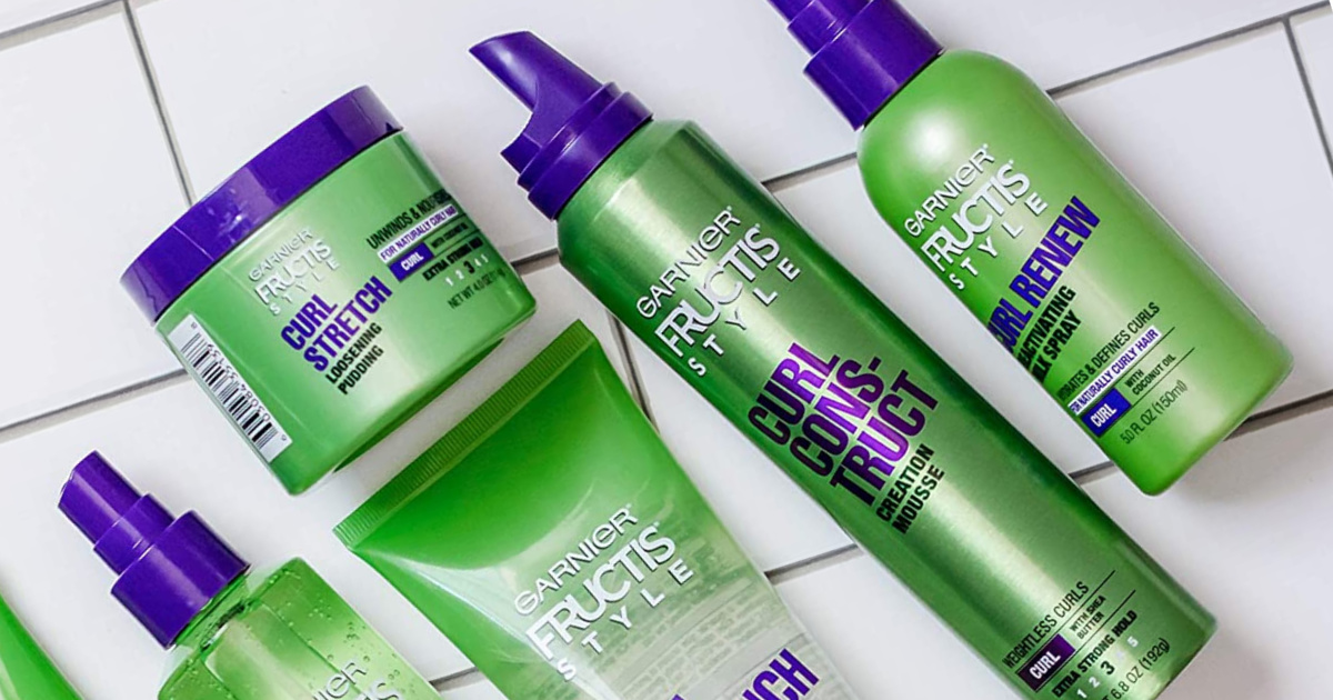 garnier fructis styling products for curly hair laid out on tile
