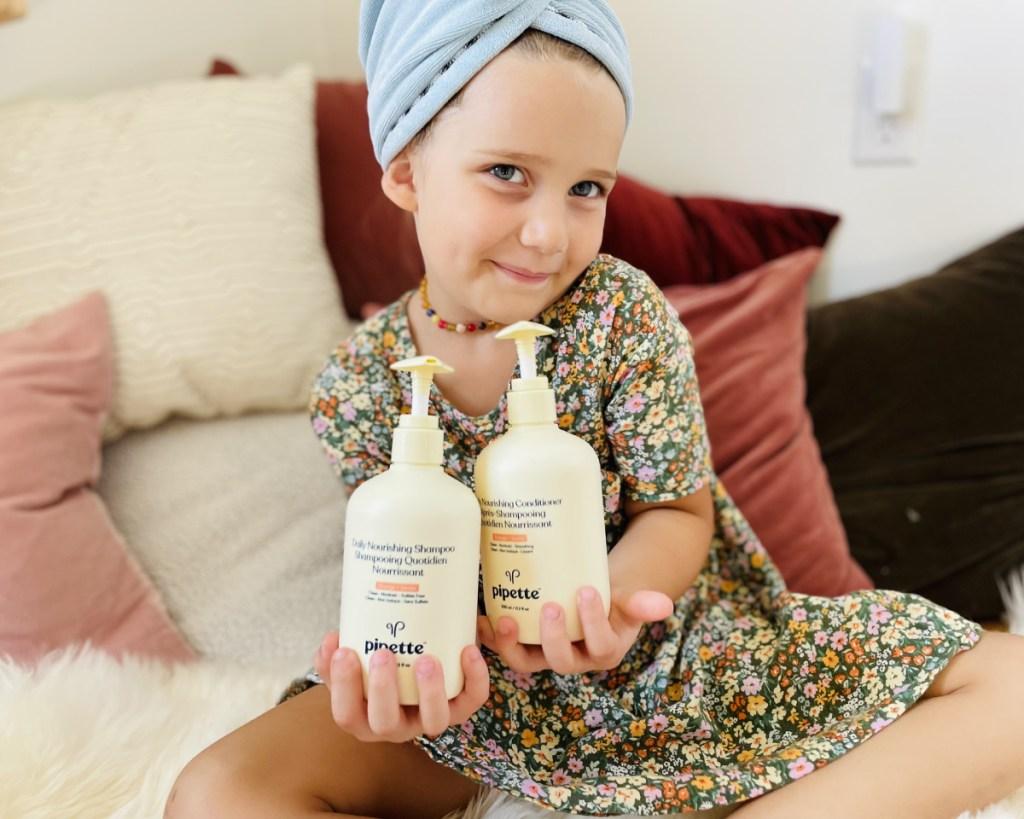 girl holding pipette bottles