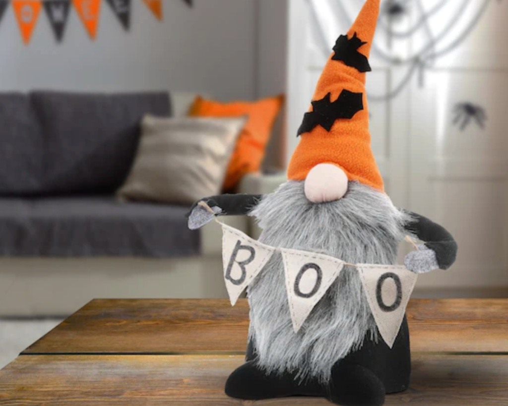 halloween gnome holding boo sign