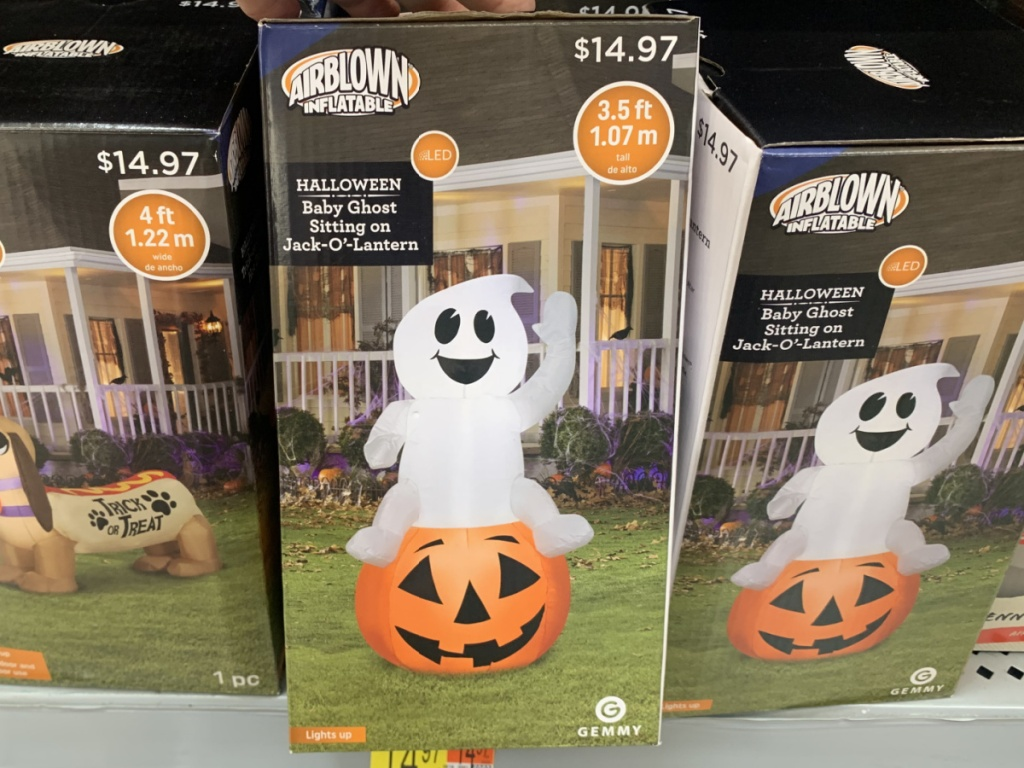 store shelf with box that has Halloween inflatable in it