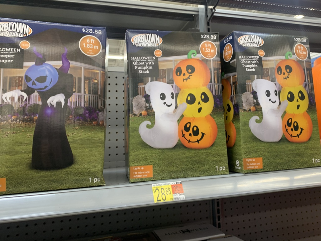 store shelf with boxes of Halloween inflatables