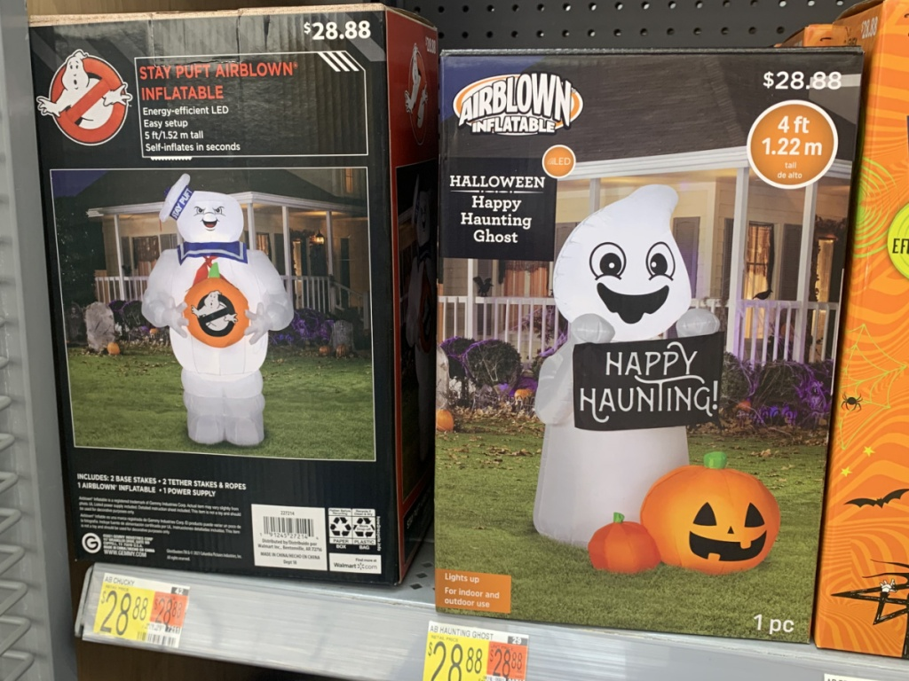 store shelf with boxes of Halloween decor on it