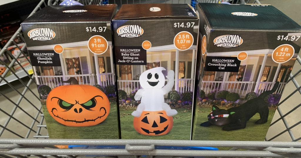 store cart with 3 boxes containing halloween inflatables in them