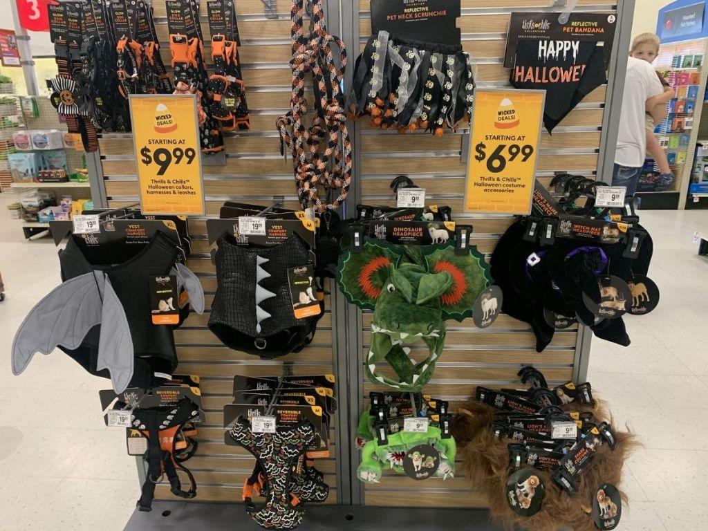 Halloween pet accessories hanging in store