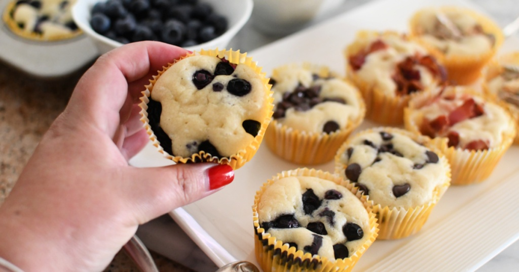 holding a blueberry pancake muffin