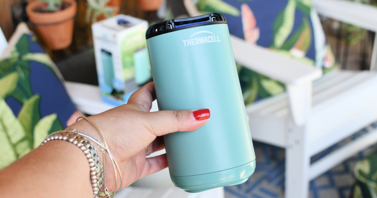 holding up a thermacell mosquito repellent device