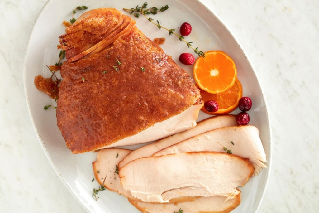 turkey breast with orange slices and cranberry