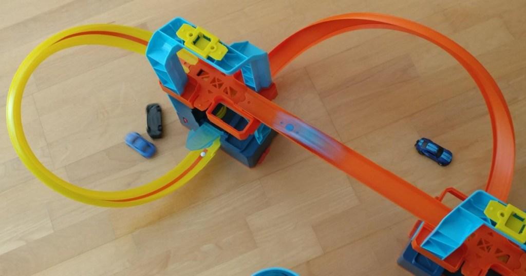 hot wheels track playset on wood floors