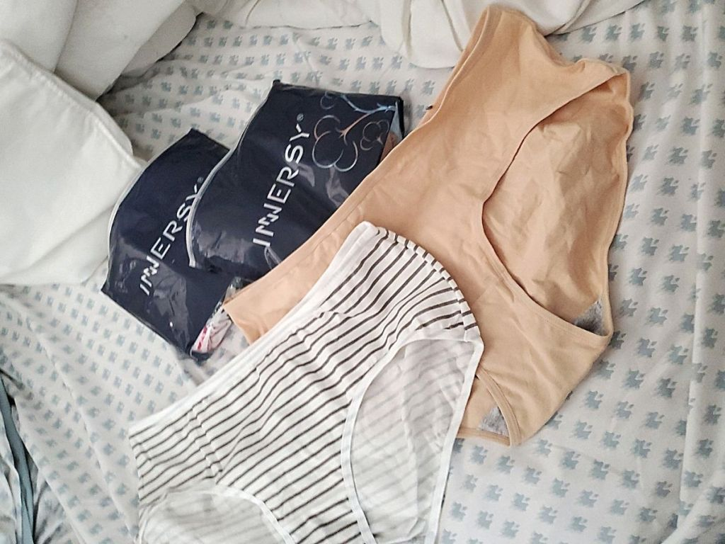 striped and tan undies on bed by Innersy bags