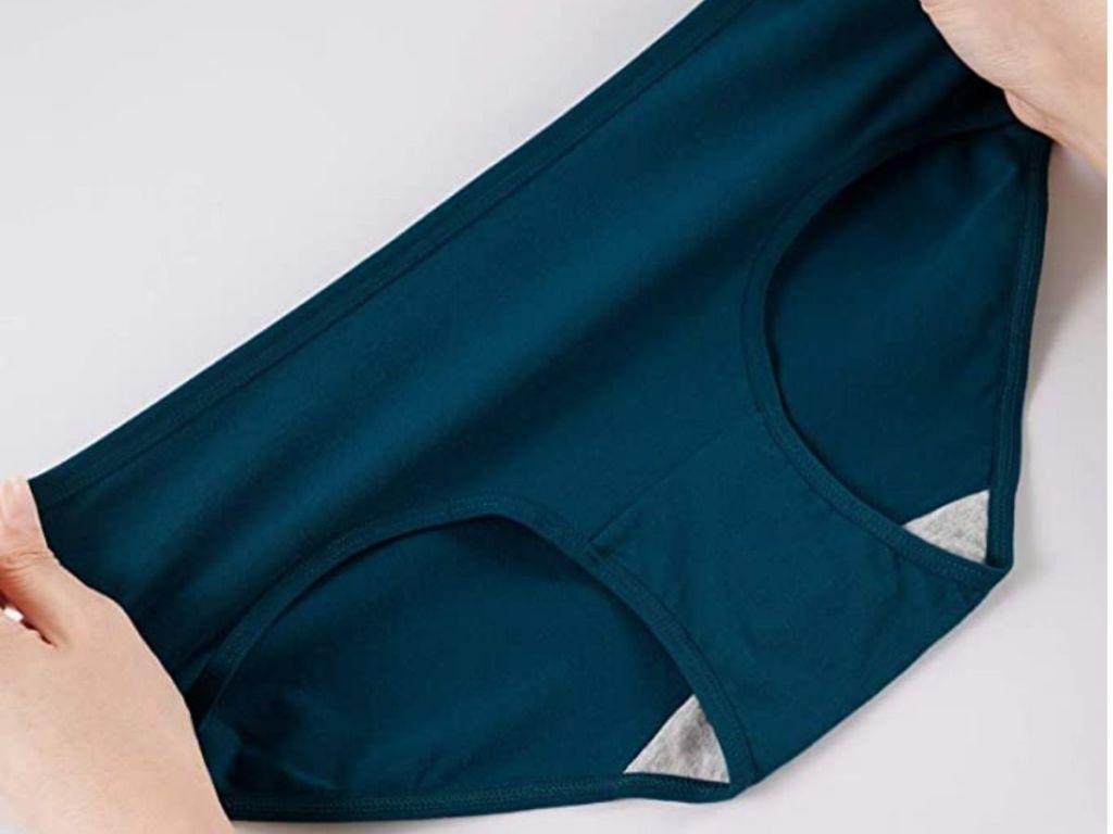 person holding blue undies