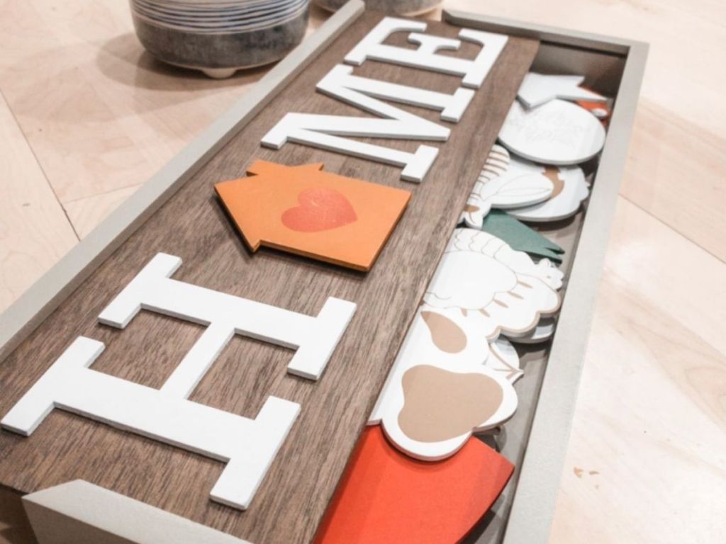 Home sign with interchangeable pieces in box