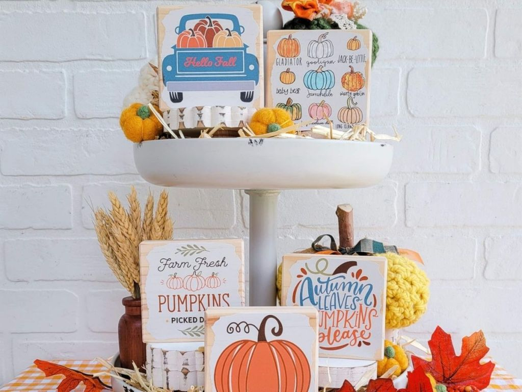 fall signs on tiered platform