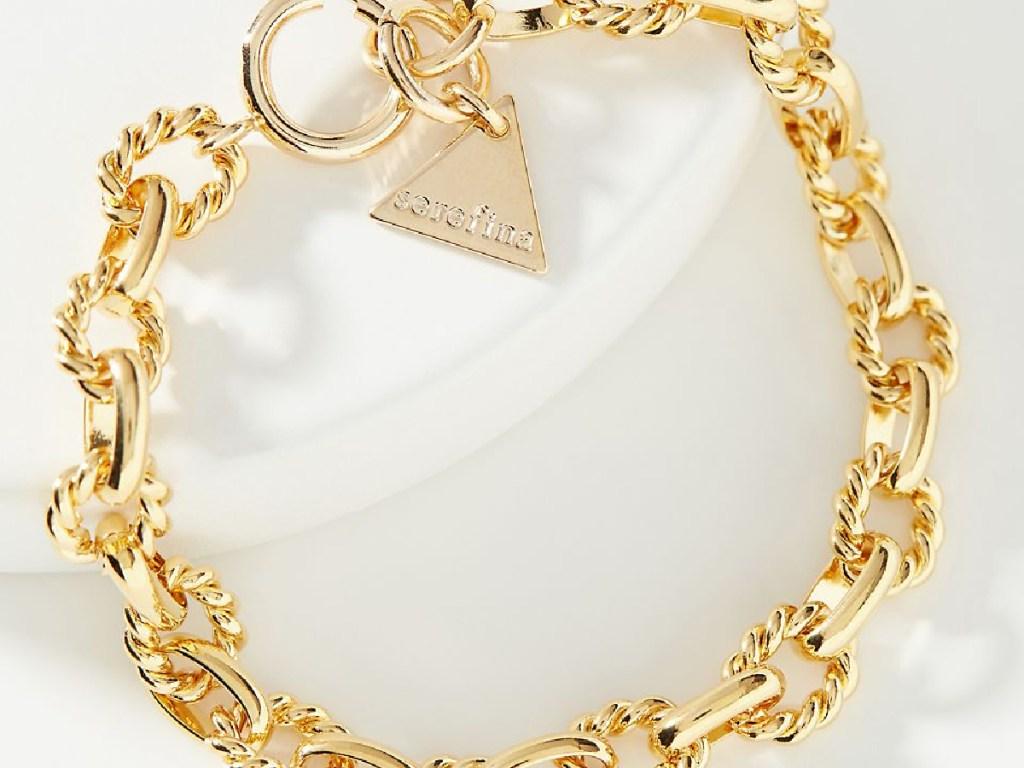 gold chain bracelet on white background