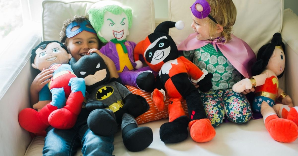 kids snuggling with plush toys