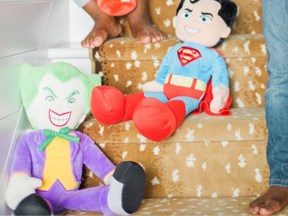 plush DC characters on stairs
