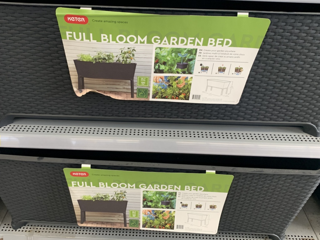 store shelf with resin garden beds on display