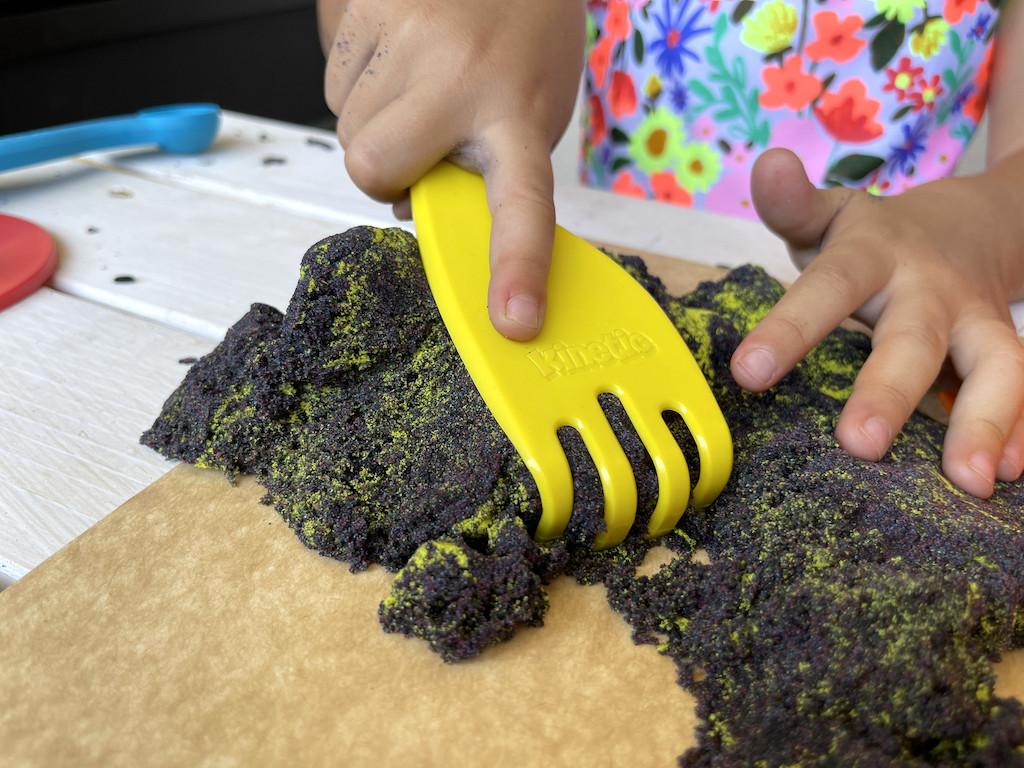 using kinetic sand with play rake
