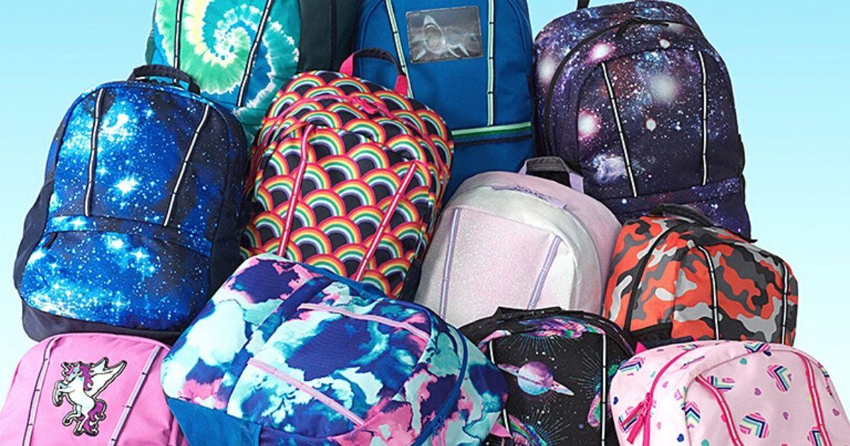 pile of Lands End backpacks