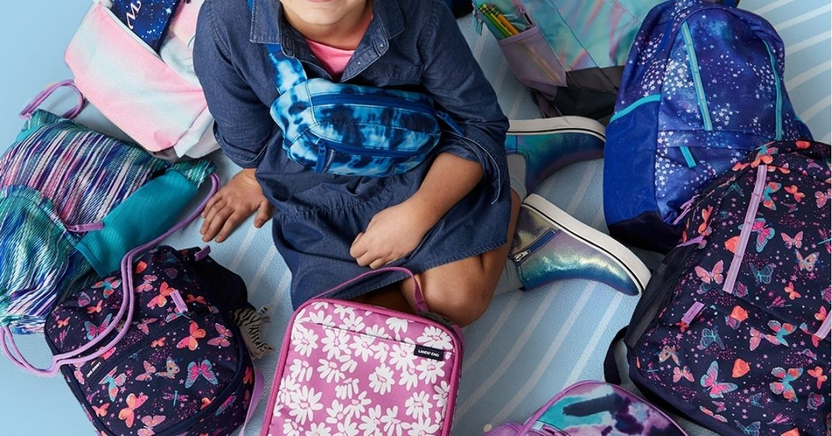 kid sitting in circle around backpacks