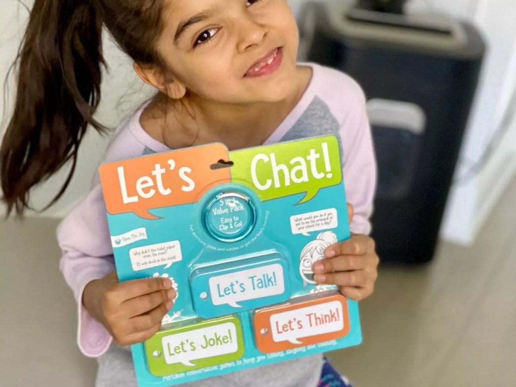girl holding Open the Joy card set