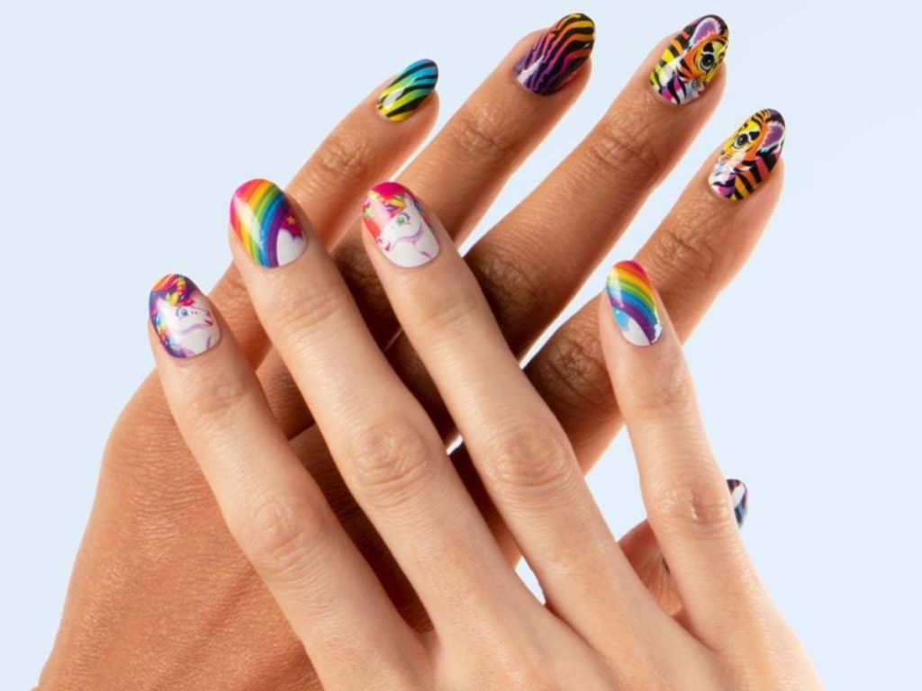 hands with designs on nails