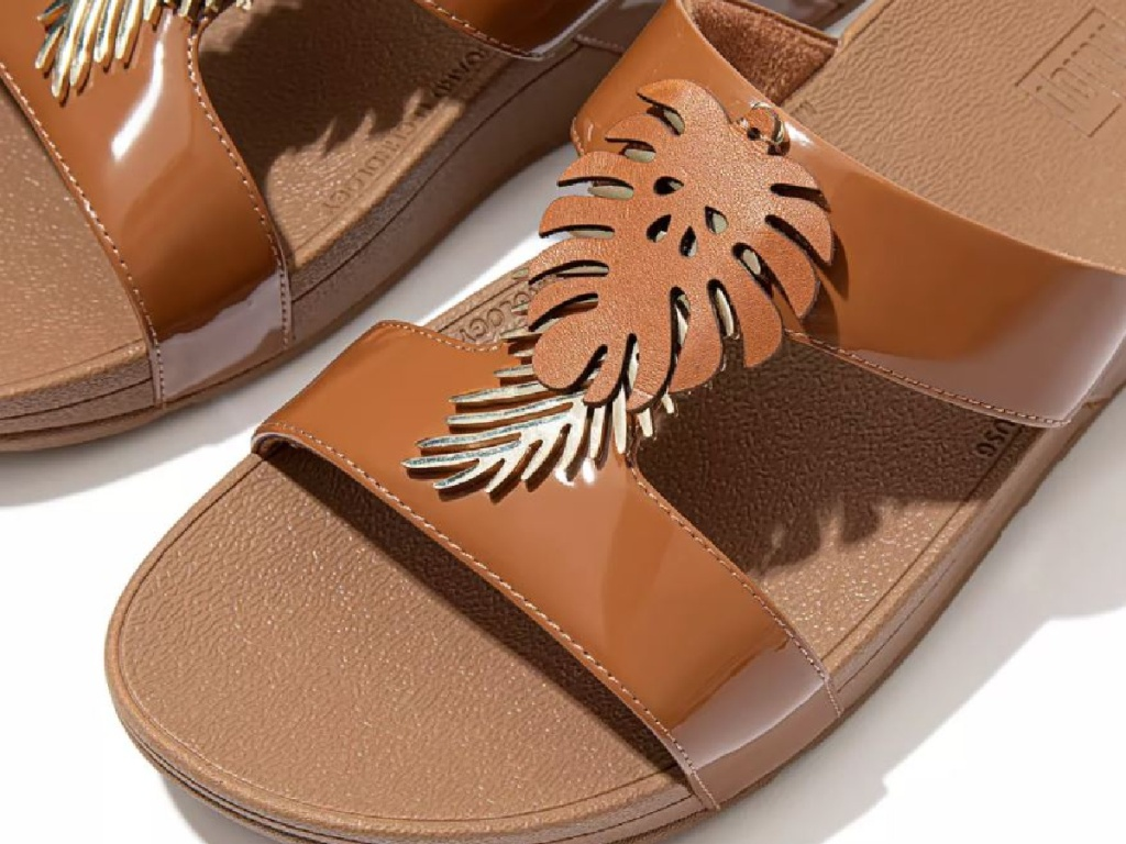 brown sandals with leaf detail