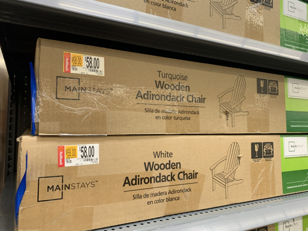 boxes with wooden chairs on store shelf