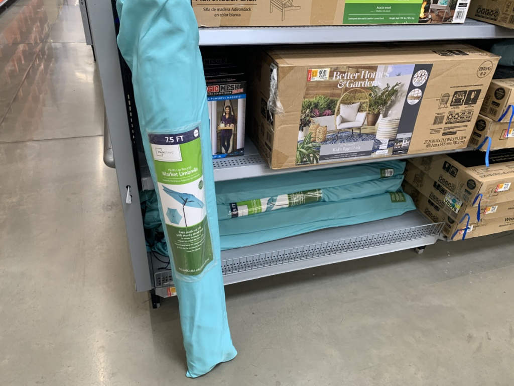 folded up umbrella in case by store aisle
