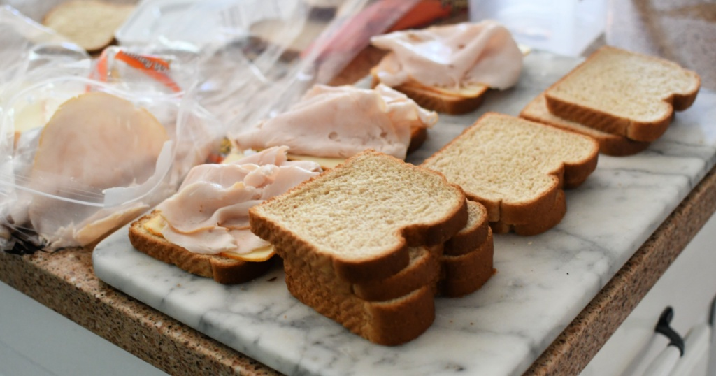 making turkey and cheese sandwiches
