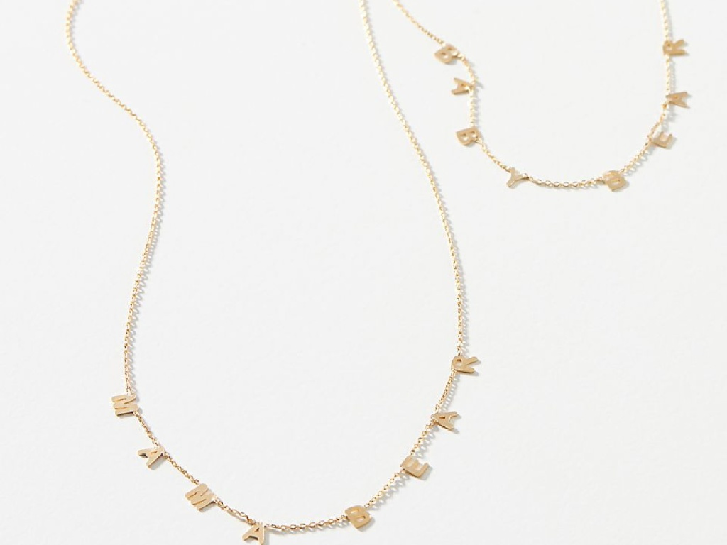 2 gold necklaces on white background