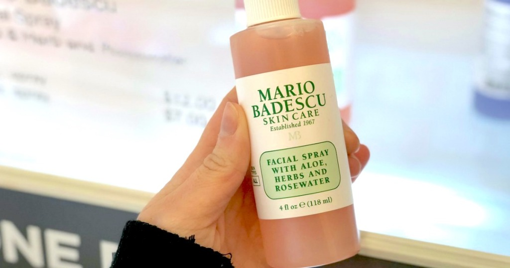 hand holding a bottle of mario badescu facial spray