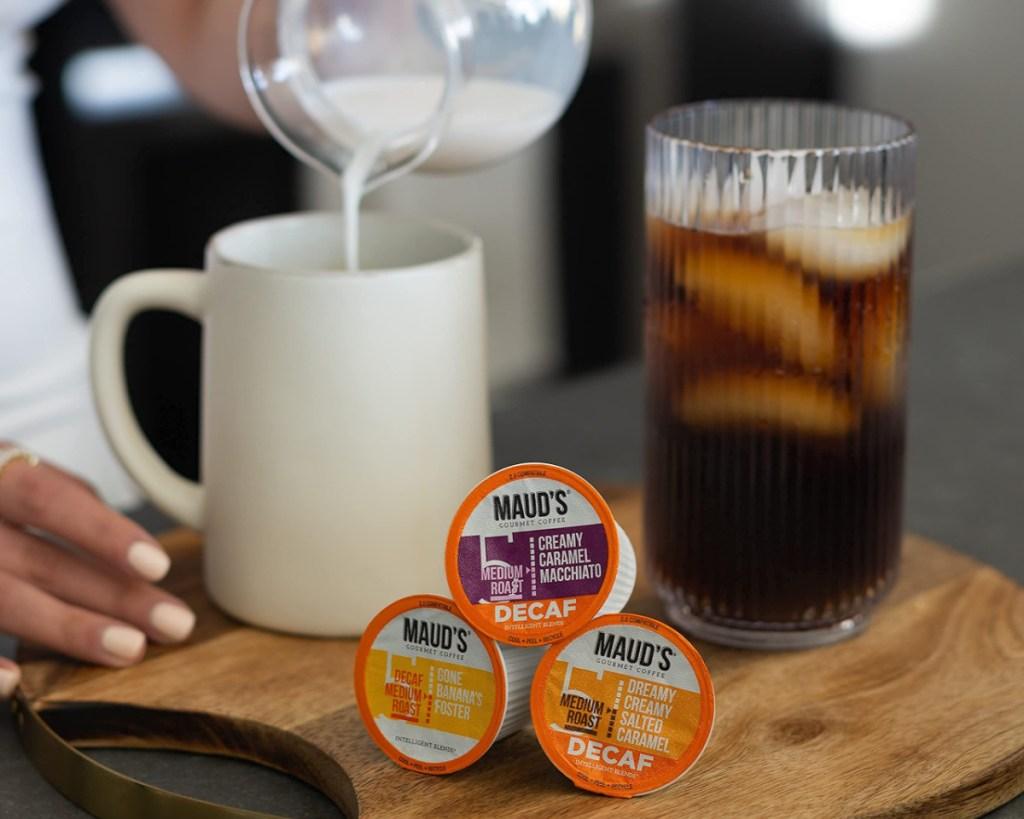 maud's decaf coffee pods next to coffee w/ milk
