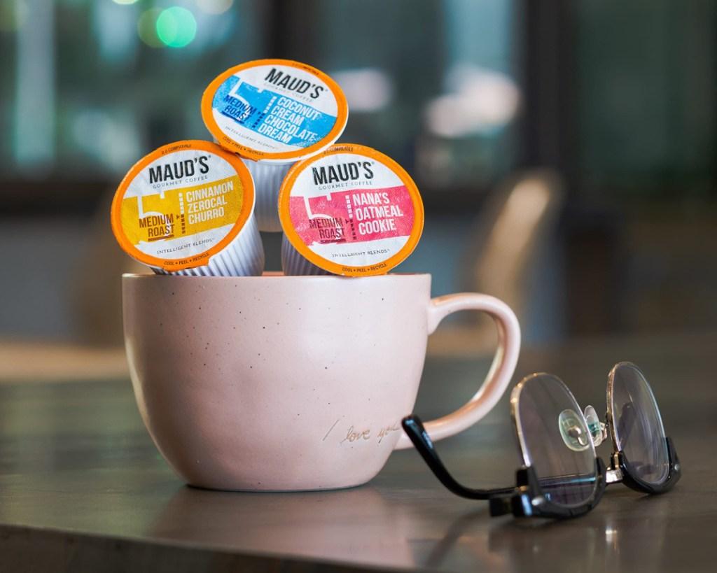 mauds super coffee pods in coffee mug