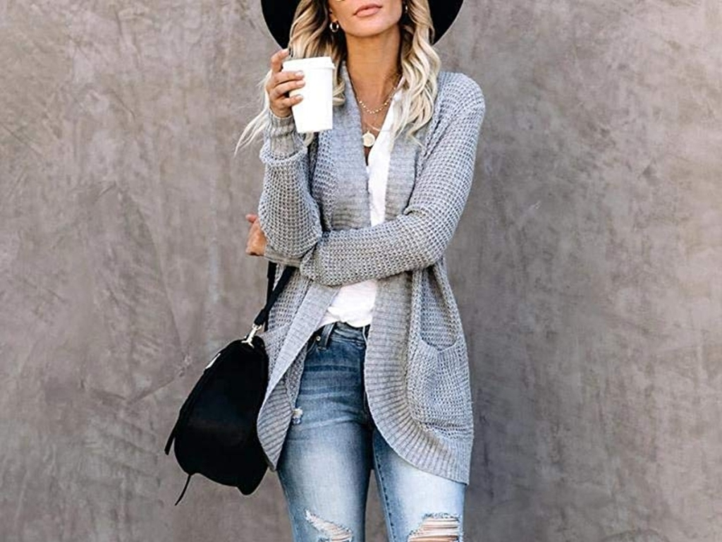 woman in gray sweater holding coffee