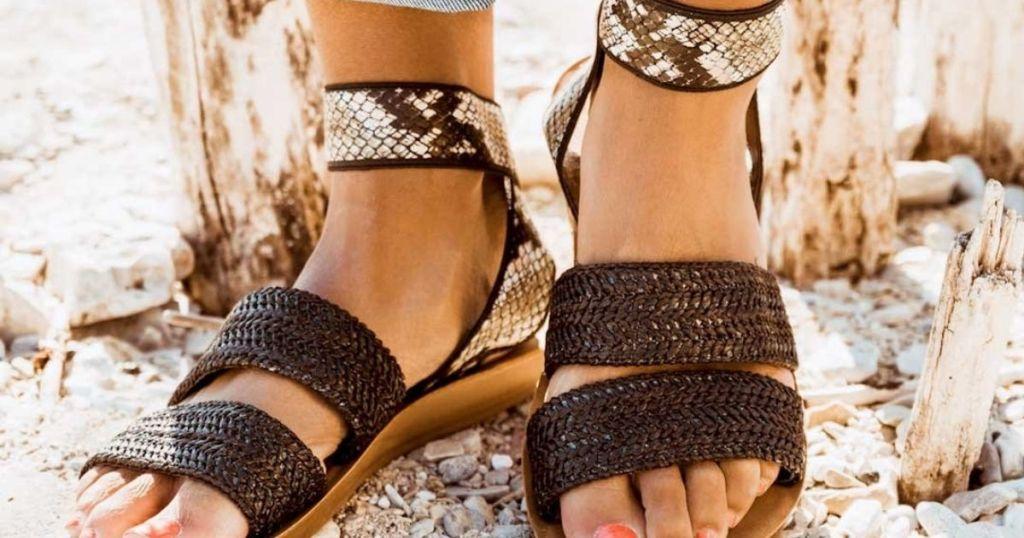 woman wearing snake skin sandals