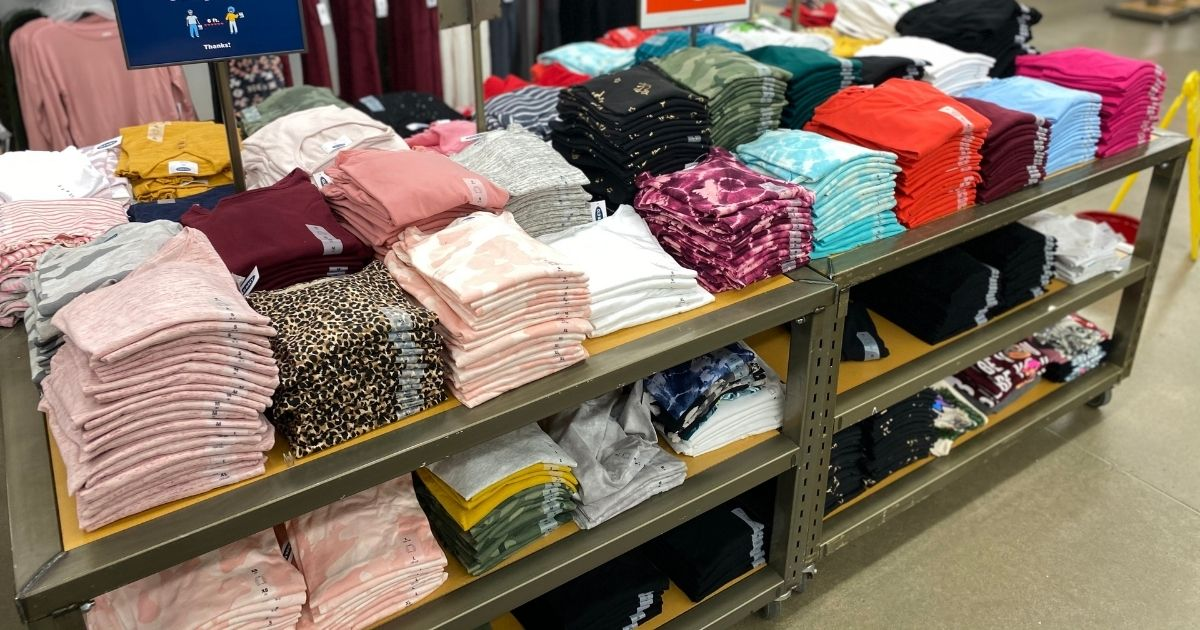 table with old navy shirts displayed