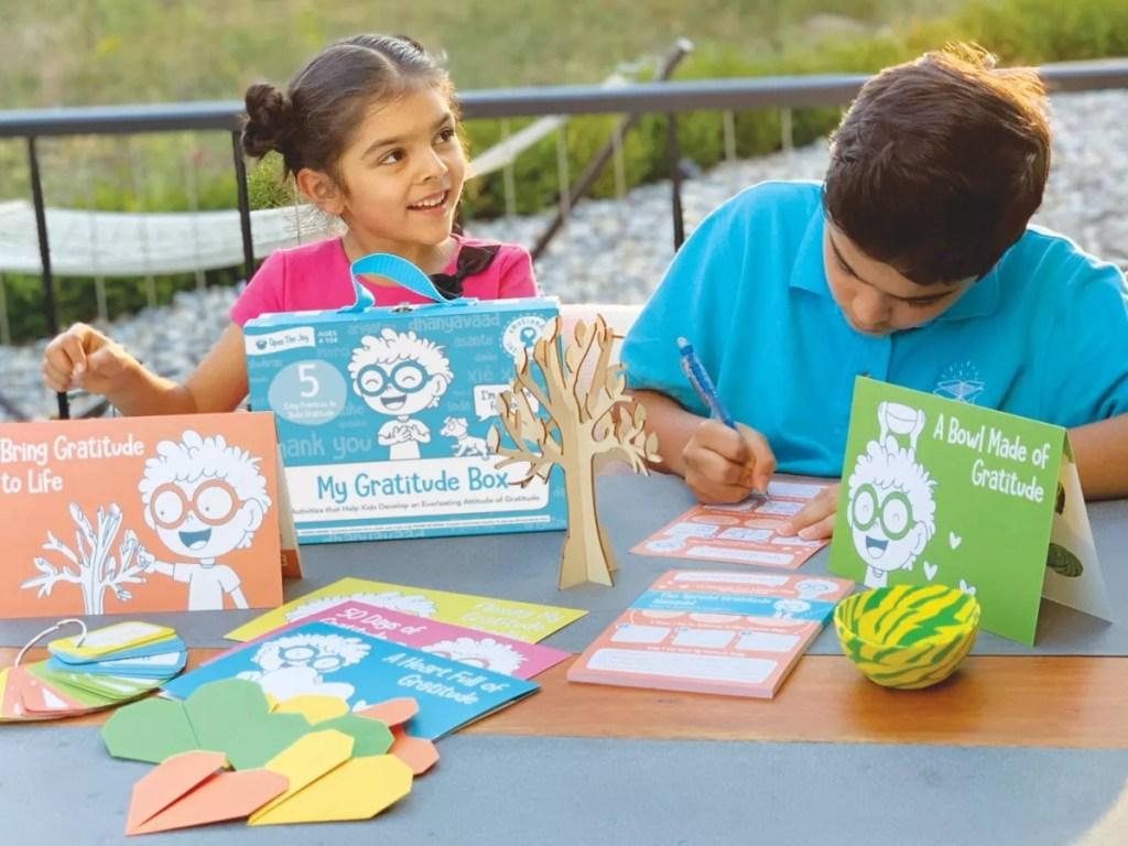 kids using contents of Gratitude Box
