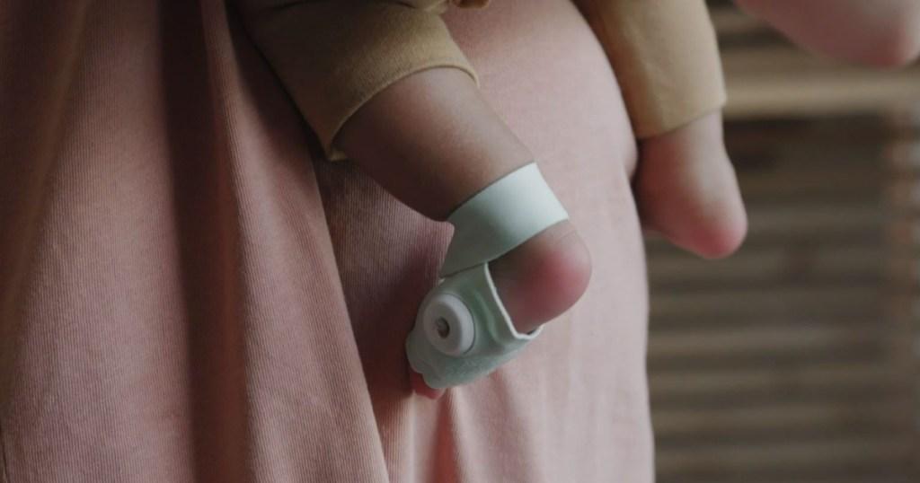 baby feet wearing little sock that monitors heart rate