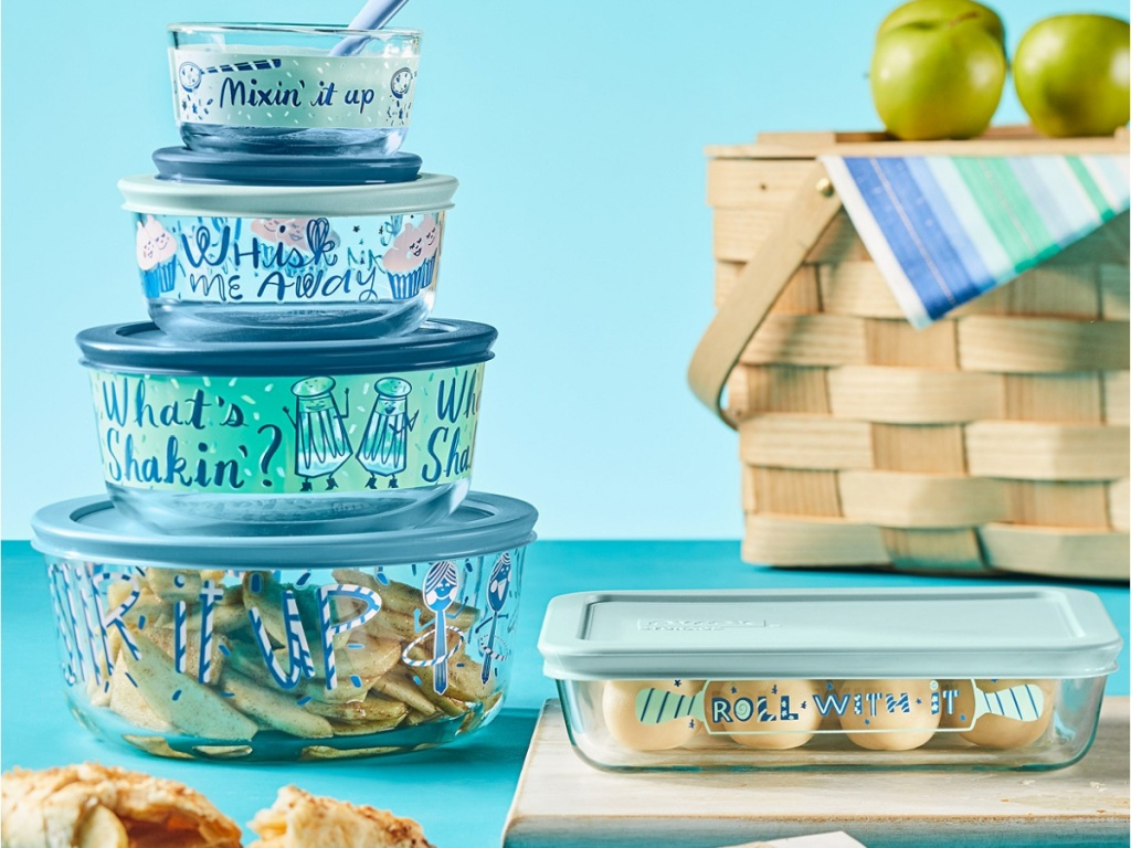 picnic set with glass dishes that are filled with food