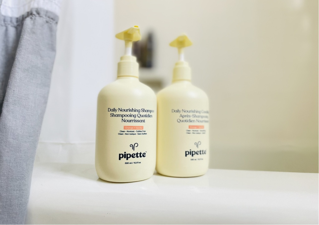 pipette shampoo and conditioner bottles on tub