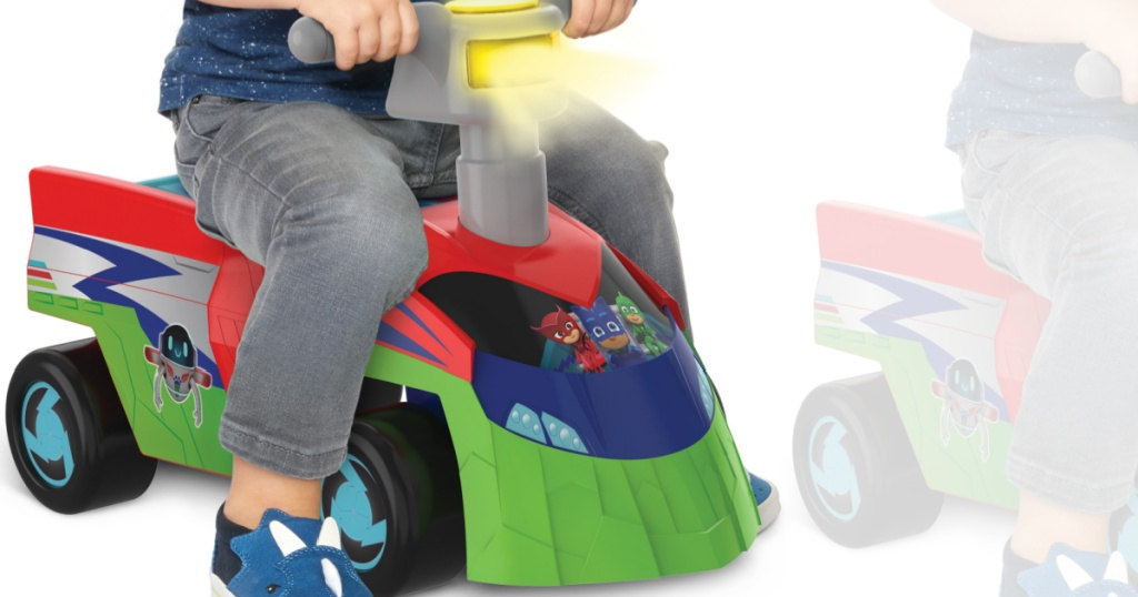 child sitting on little pretend ride on car