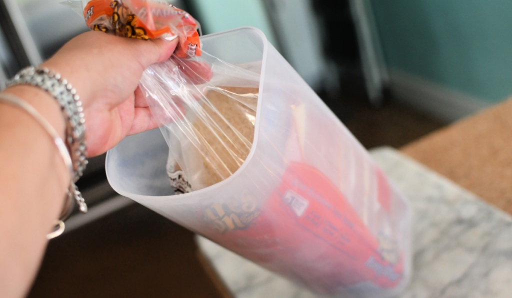 placing sandwiches in a bread storage container