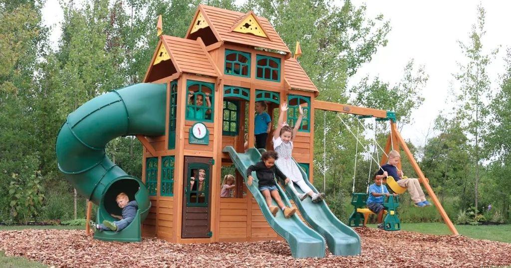 kids playing in backyard playhouse