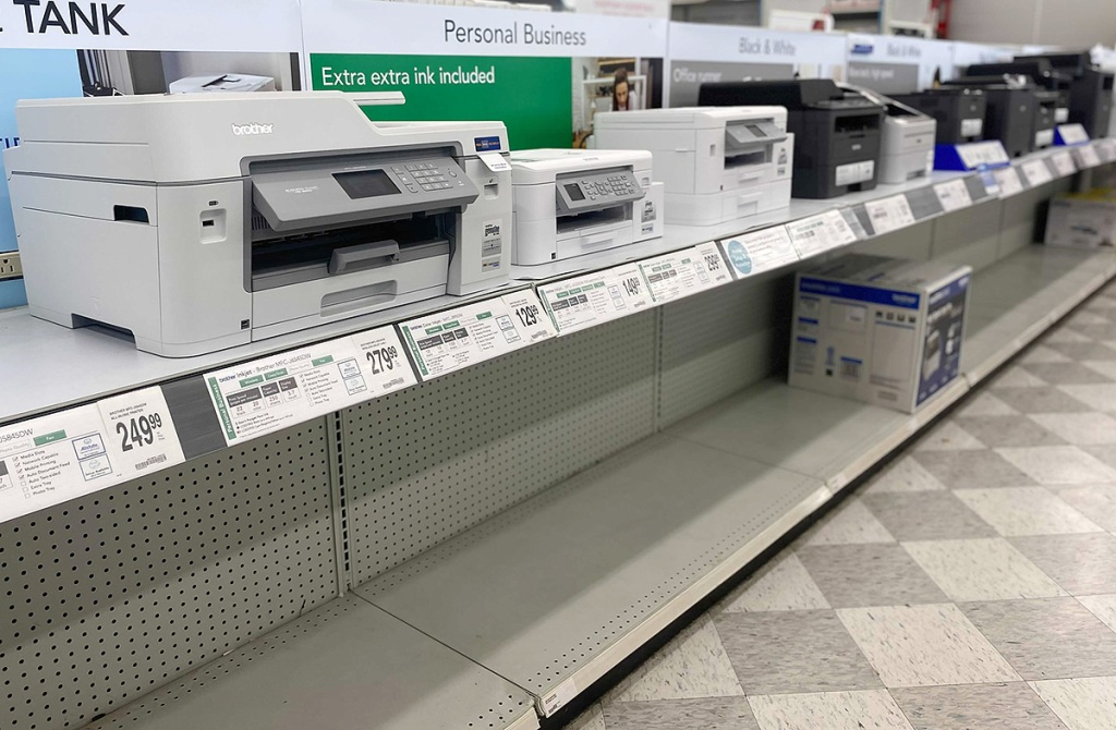 printers on shelf at office store during chip shortage