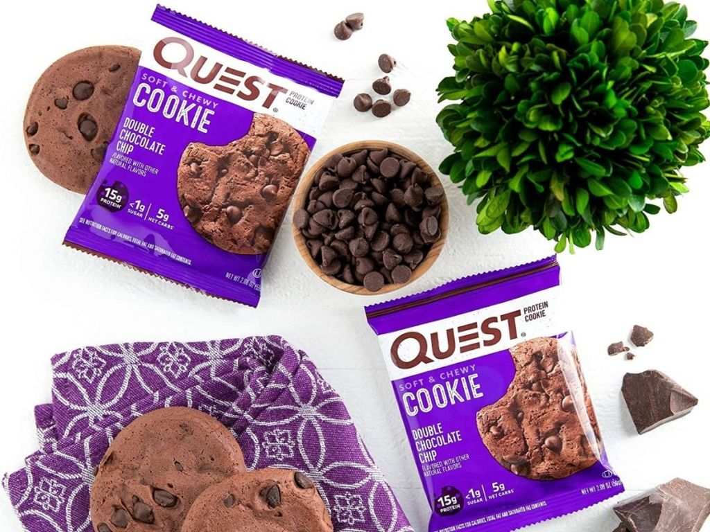 Quest cookies on table with bowl of chocolate chips