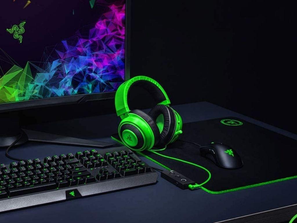 green headphones resting on computer desk
