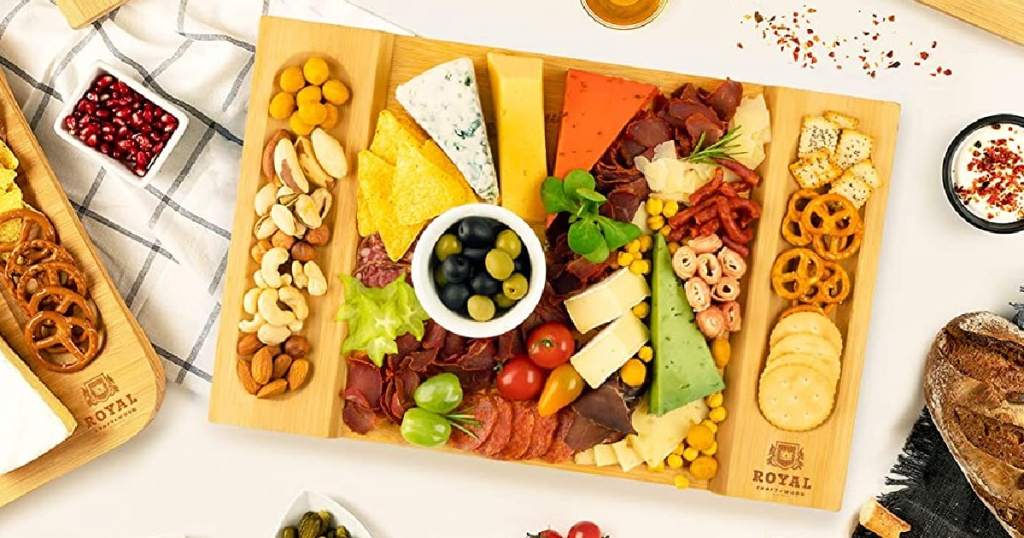 charcuterie board with cheese, meats, vegetables, nuts, and crackers