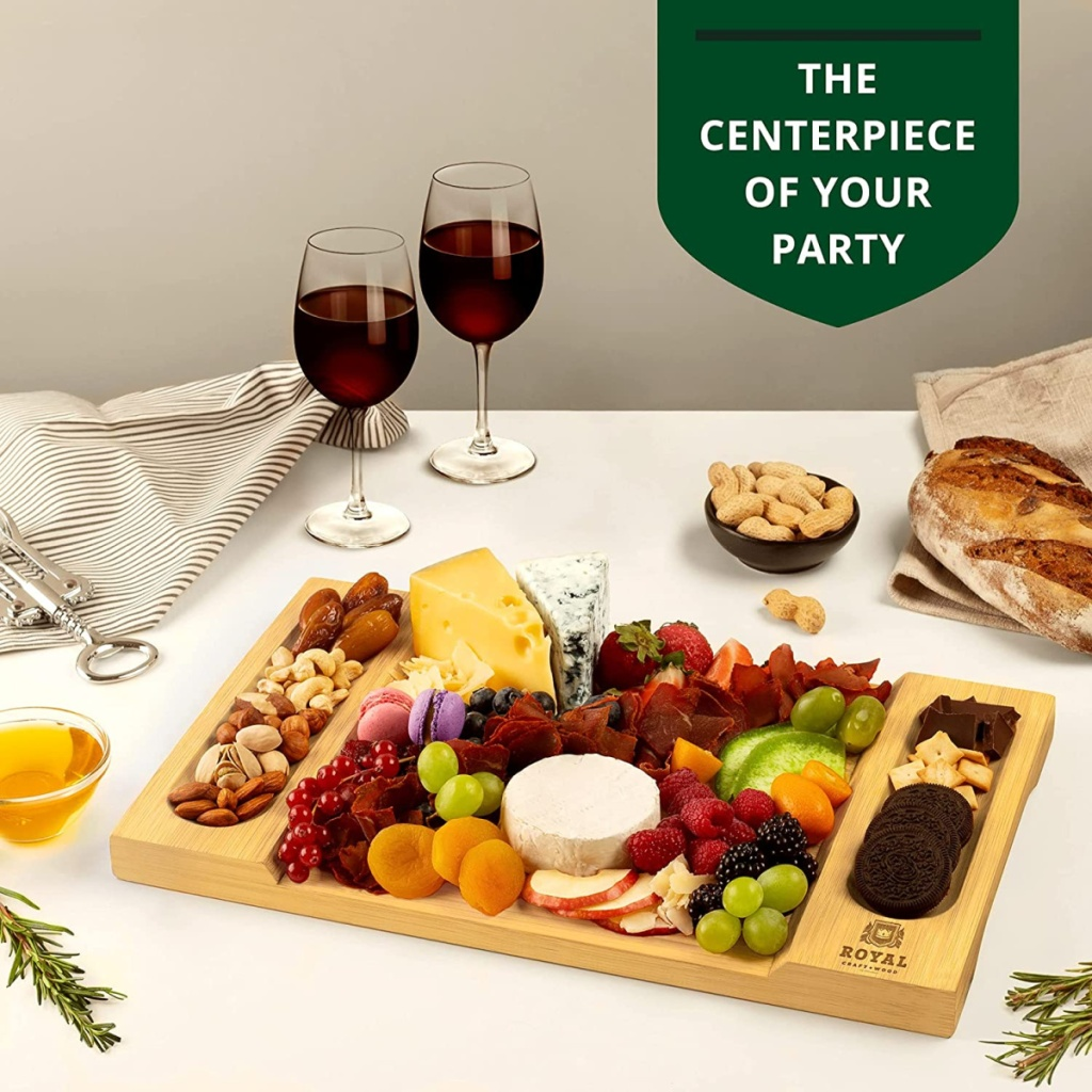 full charcuterie board in front of wine glasses on a table
